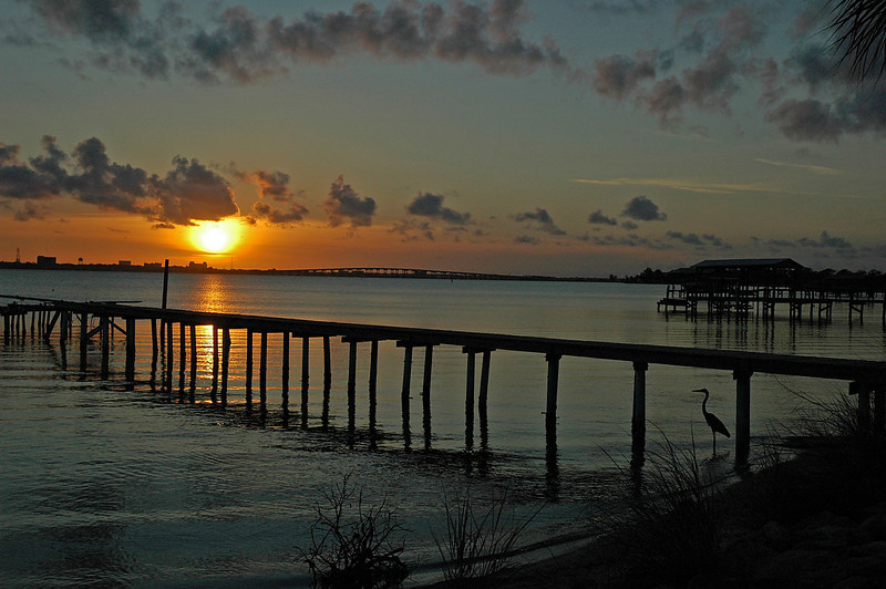 Sunset wide angle, near Rykman Park, Melbourne Beach, Florida.  That heron is still posing under the pier.