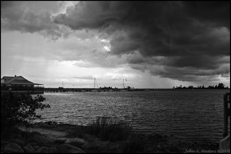 Storm clouds over Indian River Lagoon. Taken at Riverview Park in Sebastian, Florida.  Black and White.
