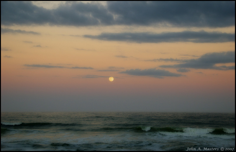 Full moon over the Atlantic Ocean,  as seen from Ocean Park in Melbourne Beach, Florida.  Orton process.