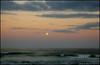 Full moon over the Atlantic Ocean,  as seen from Ocean Park in Melbourne Beach, Florida.  Orton process.