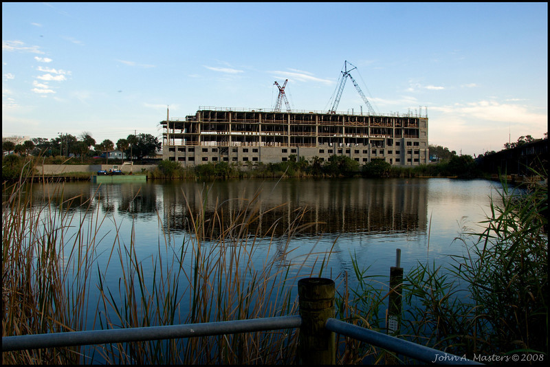 Cranes on new office building along Crane Creek in Melbourne, Florida.  Taken from Manatee Park.