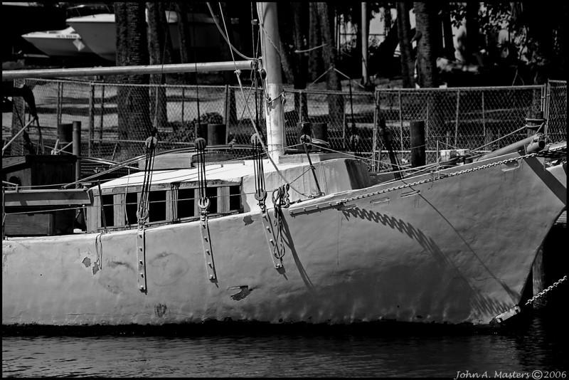 Interesting old sailboat at Melbourne Harbor Marina, Melbourne, Florida.  Black and White.