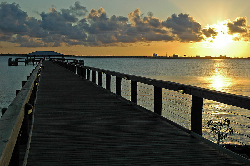 Sunset from the pier at Rykman Park, Melbourne Beach, Florida.