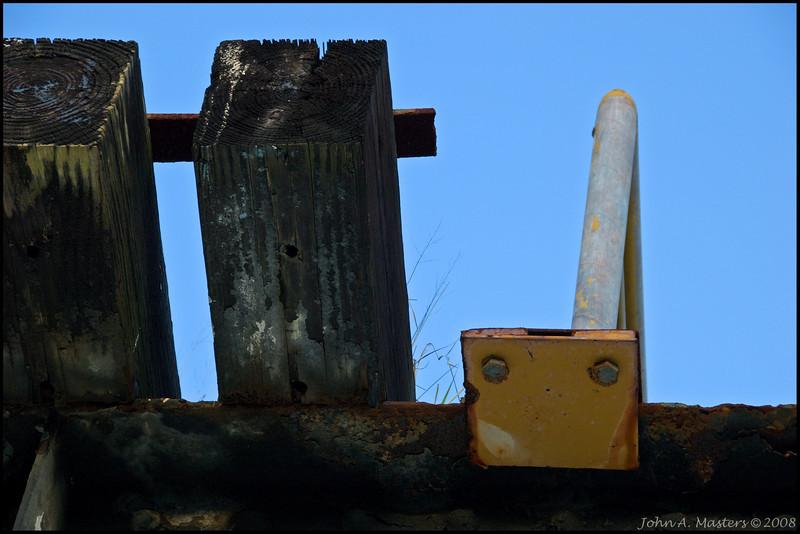 Railroad ties and guard rail on train trestle over Melbourne Avenue in Melbourne, Florida.