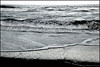 Silvery surf of the Atlantic Ocean,  as seen from Ocean Park in Melbourne Beach, Florida. Black and White.