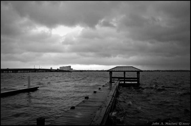 Stormy skies over the Max Brewer Causeway.  Titusville, Florida.
