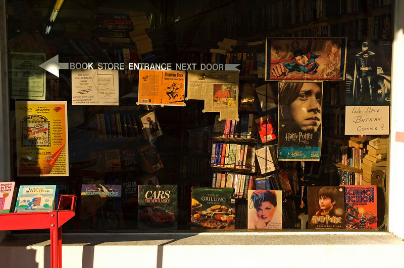 The front window of On The Shelf, a used book store in the old downtown section of Melbourne, Florida.