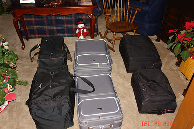 Regent Cruises's agent swept these six pieces of luggage away and we will check four more when we fly out to San Francisco on 1-4-08 for a total of 10 bags.  This many suitcases....good or bad?  We haven't a clue, this is our first World Cruise,