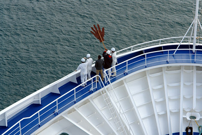 "Crew waving with their big hand to Regent's sister ship ""Seven Seas Mariner"" that was also docked in Bermuda.  Our ship was the Voyager."