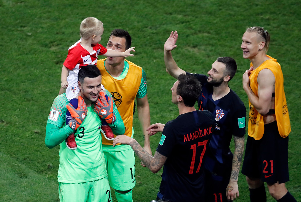 . Croatia goalkeeper Danijel Subasic, left, celebrates with his teammates after defeating Russia in a penalty shootout at the end of the quarterfinal match between Russia and Croatia at the 2018 soccer World Cup at the Fisht Stadium in Sochi, Russia, Saturday, July 7, 2018. (AP Photo/Alexander Zemlianichenko)