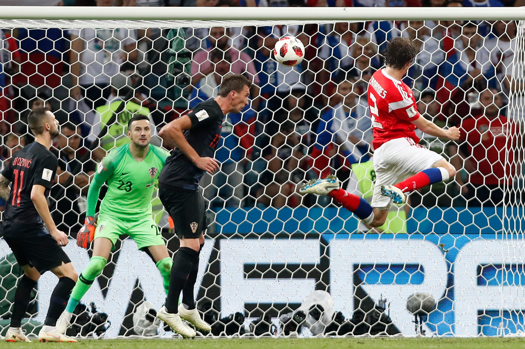 . Russia\'s Mario Fernandes , right, scores his side\'s second goal during the quarterfinal match between Russia and Croatia at the 2018 soccer World Cup in the Fisht Stadium, in Sochi, Russia, Saturday, July 7, 2018. (AP Photo/Rebecca Blackwell)