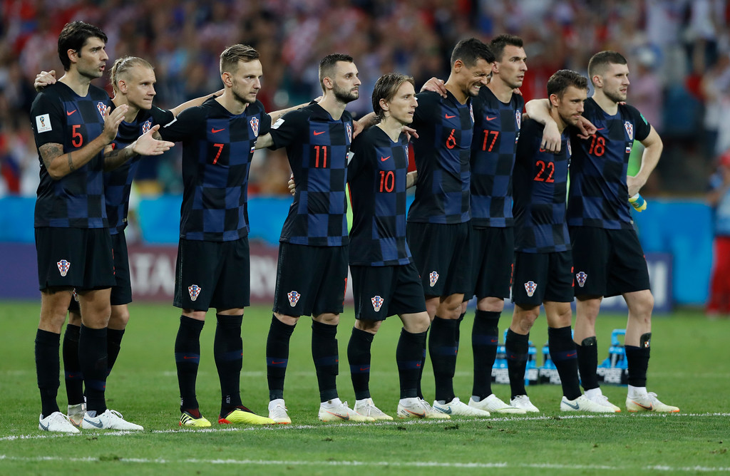 . Croatia team players watch penalties during the quarterfinal match between Russia and Croatia at the 2018 soccer World Cup in the Fisht Stadium, in Sochi, Russia, Saturday, July 7, 2018. (AP Photo/Darko Bandic)