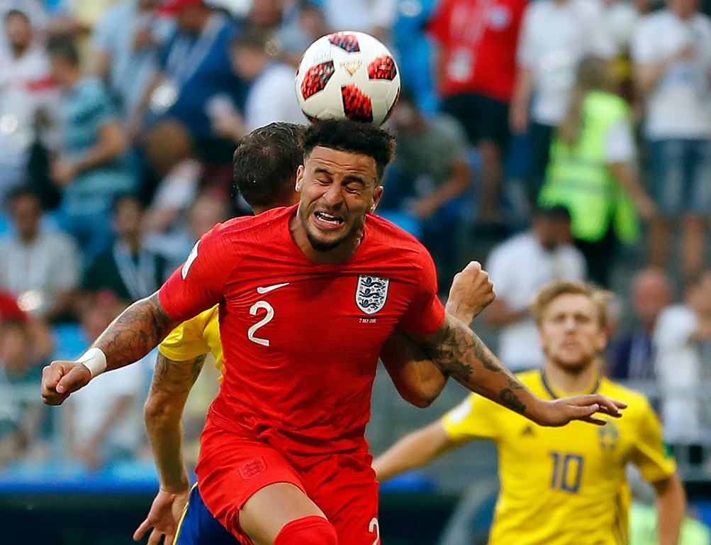 . England\'s Kyle Walker heads the ball during the quarterfinal match between Sweden and England at the 2018 soccer World Cup in the Samara Arena, in Samara, Russia, Saturday, July 7, 2018. (AP Photo/Francisco Seco)