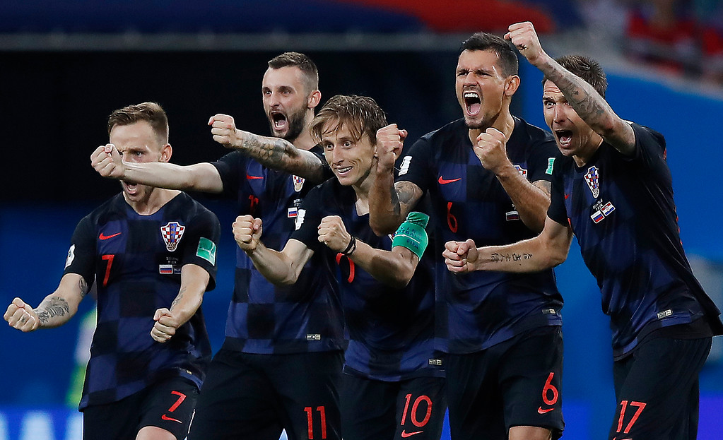 . Croatia national soccer team players celebrate after a penalty is saved in a shootout during the quarterfinal match between Russia and Croatia at the 2018 soccer World Cup in the Fisht Stadium, in Sochi, Russia, Saturday, July 7, 2018. Croatia won the match 4-3 on penalties after the game ended 2-2 after extra time. (AP Photo/Manu Fernandez)