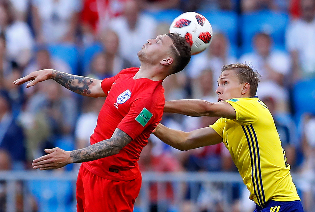. England\'s Kieran Trippier, left, jumps for the ball with Sweden\'s Ludwig Augustinsson during the quarterfinal match between Sweden and England at the 2018 soccer World Cup in the Samara Arena, in Samara, Russia, Saturday, July 7, 2018. (AP Photo/Alastair Grant)