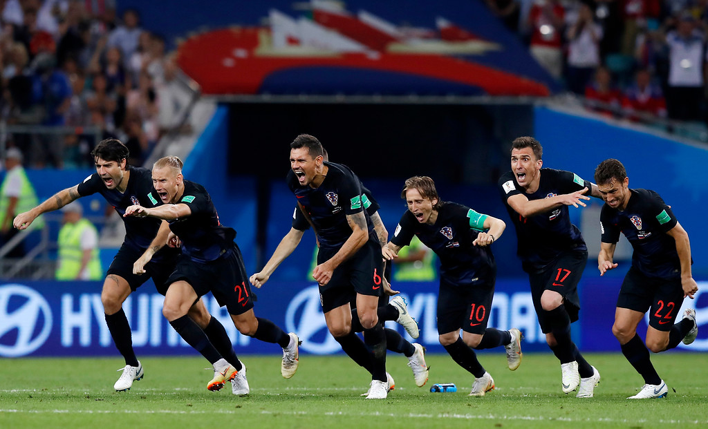 . Croatia national soccer team players celebrate after winning the quarterfinal match between Russia and Croatia at the 2018 soccer World Cup in the Fisht Stadium, in Sochi, Russia, Saturday, July 7, 2018. (AP Photo/Manu Fernandez)
