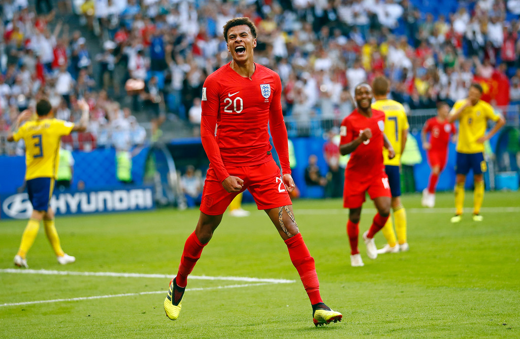 . England\'s Dele Alli celebrates after scoring his side\'s second goal during the quarterfinal match between Sweden and England at the 2018 soccer World Cup in the Samara Arena, in Samara, Russia, Saturday, July 7, 2018. (AP Photo/Matthias Schrader)