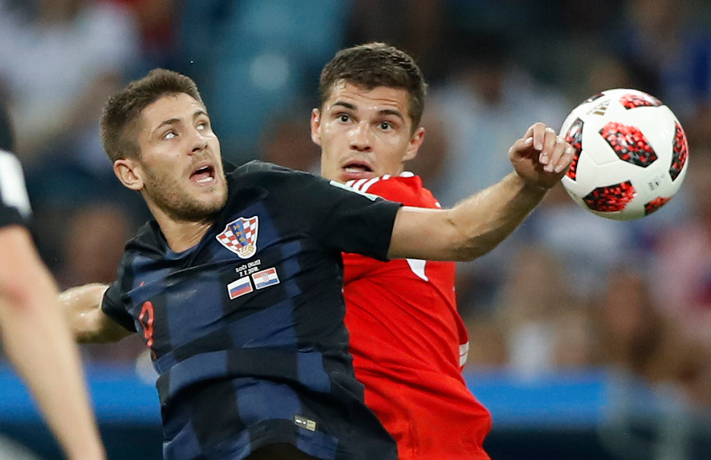 . Croatia\'s Andrej Kramaric, left, vies for the ball with Russia\'s Roman Zobnin during the quarterfinal match between Russia and Croatia at the 2018 soccer World Cup in the Fisht Stadium, in Sochi, Russia, Saturday, July 7, 2018. (AP Photo/Darko Bandic)