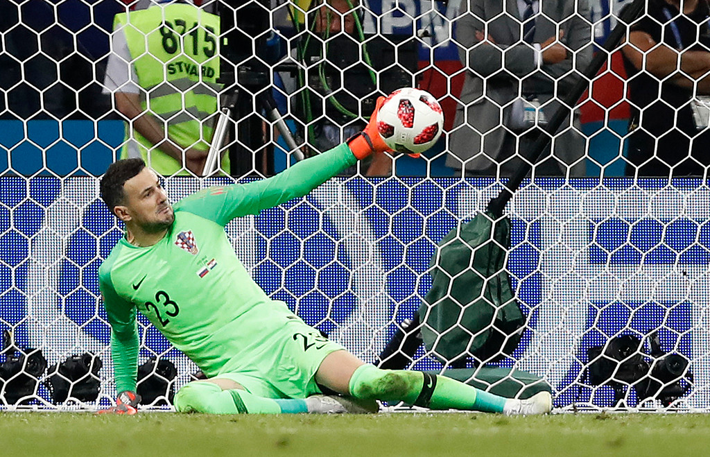. Croatia goalkeeper Danijel Subasic makes a save during the penalty shootout from Russia\'s Fyodor Smolov during the quarterfinal match between Russia and Croatia at the 2018 soccer World Cup in the Fisht Stadium, in Sochi, Russia, Saturday, July 7, 2018. (AP Photo/Rebecca Blackwell)