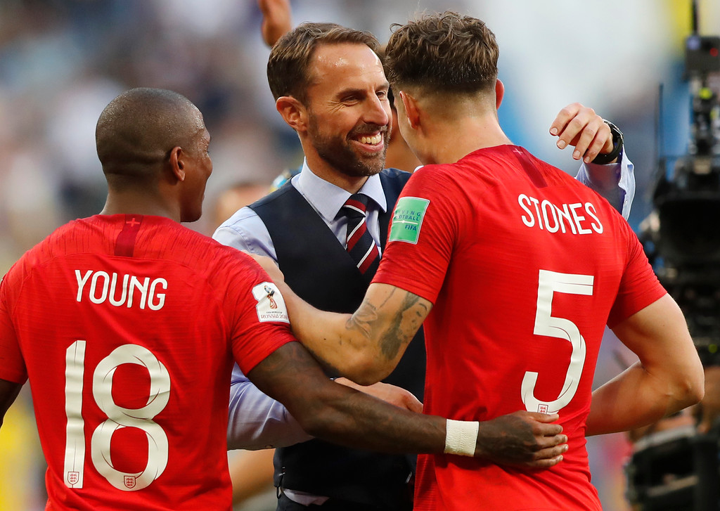 . England\'s Ashley Young, left, head coach Gareth Southgate and John Stones celebrate their victory over Sweden during the quarterfinal match between Sweden and England at the 2018 soccer World Cup in the Samara Arena, in Samara, Russia, Saturday, July 7, 2018. (AP Photo/Frank Augstein)