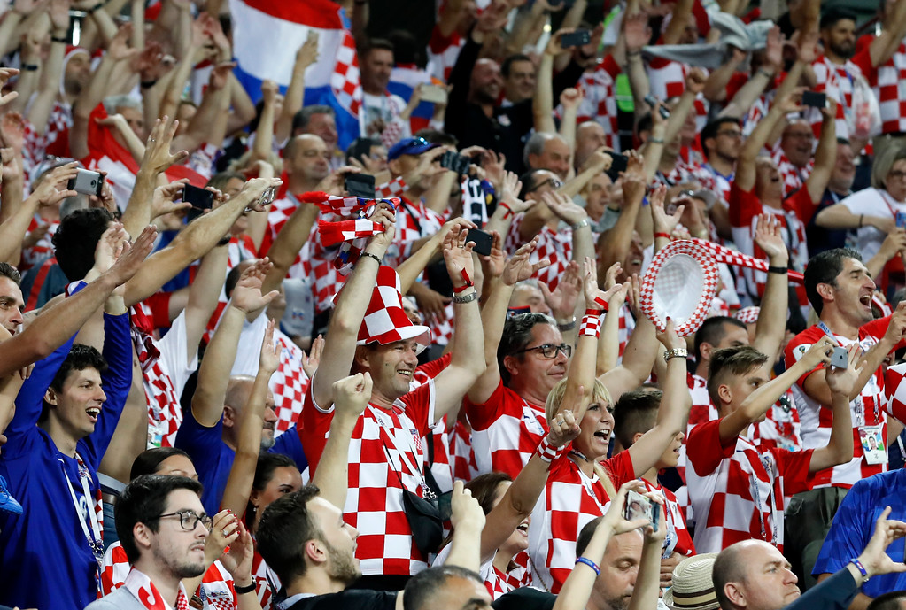 . Croatia fans celebrate after winning the quarterfinal match between Russia and Croatia at the 2018 soccer World Cup in the Fisht Stadium, in Sochi, Russia, Saturday, July 7, 2018. (AP Photo/Rebecca Blackwell)