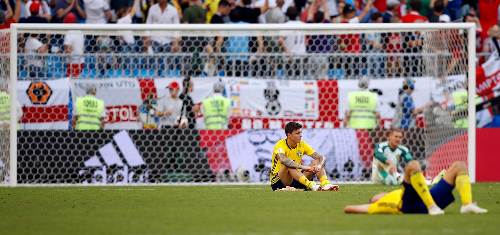 . Swedish players appear dejected after losing from England at the quarterfinal match between Sweden and England at the 2018 soccer World Cup in the Samara Arena, in Samara, Russia, Saturday, July 7, 2018. (AP Photo/Francisco Seco)