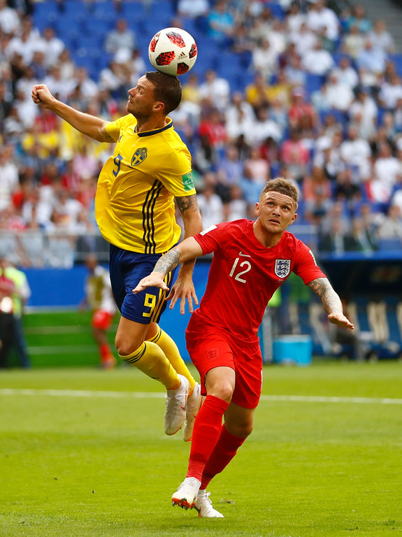 . Sweden\'s Marcus Berg, left, and England\'s Kieran Trippier battle for the ball during the quarterfinal match between Sweden and England at the 2018 soccer World Cup in the Samara Arena, in Samara, Russia, Saturday, July 7, 2018. (AP Photo/Matthias Schrader)