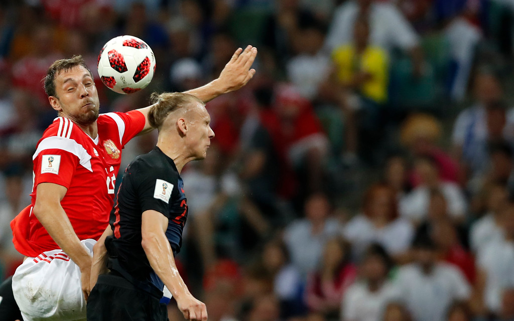 . Russia\'s Artyom Dzyuba, left, jumps for the ball with Croatia\'s Domagoj Vida during the quarterfinal match between Russia and Croatia at the 2018 soccer World Cup in the Fisht Stadium, in Sochi, Russia, Saturday, July 7, 2018. (AP Photo/Rebecca Blackwell)