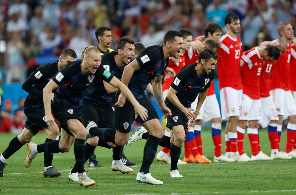 . Croatia players celebrate after scoring the winning penalty in a shootout at the end the quarterfinal match between Russia and Croatia at the 2018 soccer World Cup in the Fisht Stadium, in Sochi, Russia, Saturday, July 7, 2018. (AP Photo/Darko Bandic)