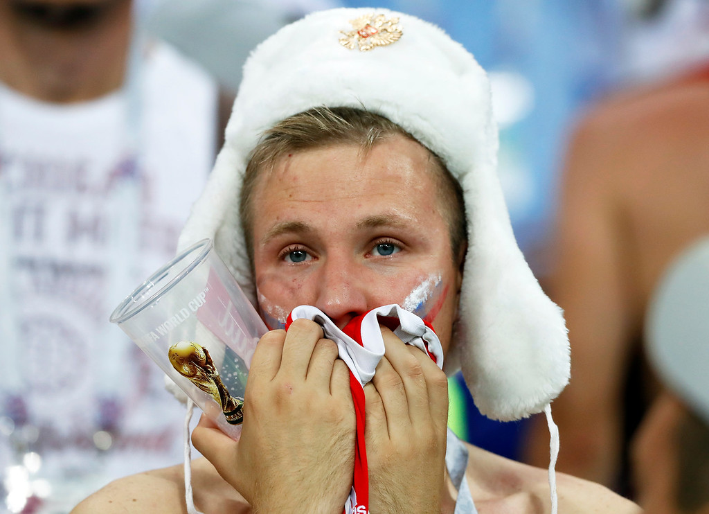 . A Russia\'s fan reacts after Russia\'s loss in the quarterfinal match between Russia and Croatia at the 2018 soccer World Cup in the Fisht Stadium, in Sochi, Russia, Saturday, July 7, 2018. (AP Photo/Darko Bandic)