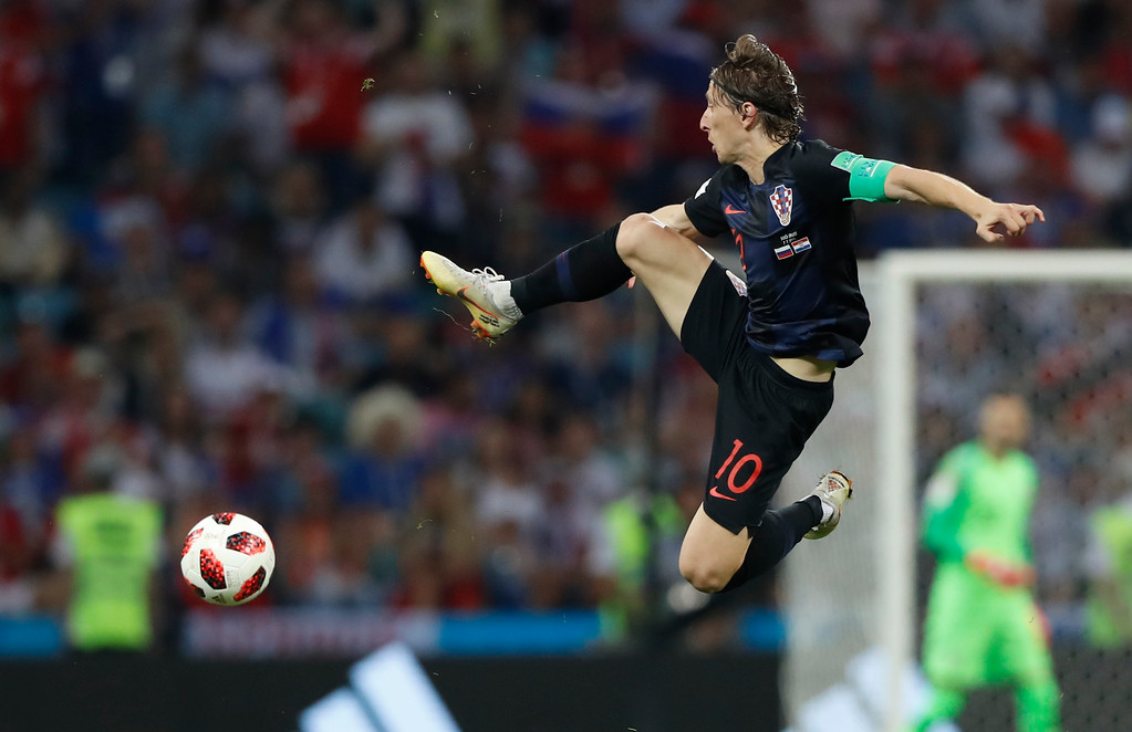 . Croatia\'s Luka Modric jumps for the ball during the quarterfinal match between Russia and Croatia at the 2018 soccer World Cup in the Fisht Stadium, in Sochi, Russia, Saturday, July 7, 2018. (AP Photo/Darko Bandic)