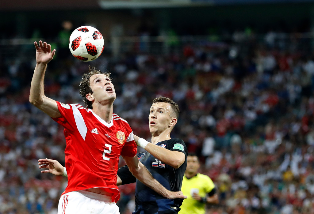 . Russia\'s Mario Fernandes, left, jumps for the ball with Croatia\'s Ivan Perisic during the quarterfinal match between Russia and Croatia at the 2018 soccer World Cup in the Fisht Stadium, in Sochi, Russia, Saturday, July 7, 2018. (AP Photo/Rebecca Blackwell)