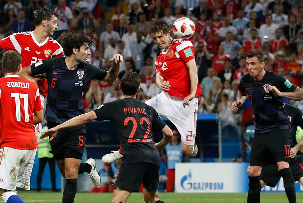 . Russia\'s Mario Fernandes , centre, scores his side\'s second goal during the quarterfinal match between Russia and Croatia at the 2018 soccer World Cup in the Fisht Stadium, in Sochi, Russia, Saturday, July 7, 2018. (AP Photo/Darko Bandic)