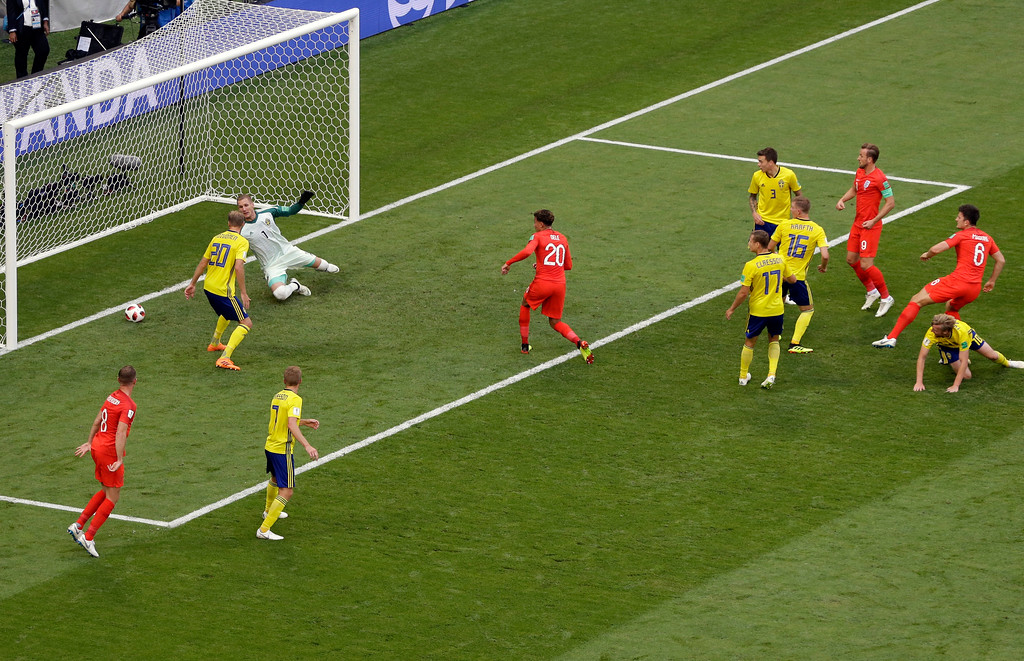 . England\'s Harry Maguire, right, scores the opening goal during the quarterfinal match between Sweden and England at the 2018 soccer World Cup in the Samara Arena, in Samara, Russia, Saturday, July 7, 2018. (AP Photo/Thanassis Stavrakis)