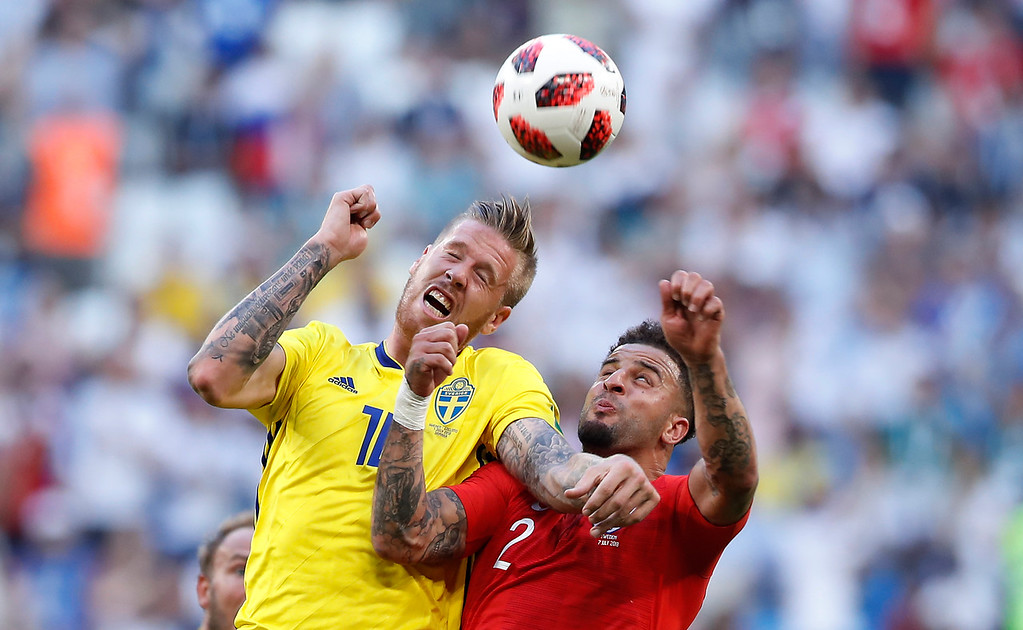 . Sweden\'s Pontus Jansson, left, challenges for the ball with England\'s Kyle Walker during the quarterfinal match between Sweden and England at the 2018 soccer World Cup in the Samara Arena, in Samara, Russia, Saturday, July 7, 2018. (AP Photo/Alastair Grant)