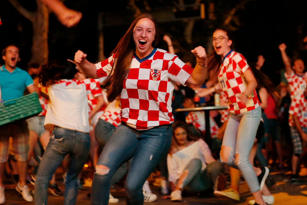 . Bosnian Croats, in the streets of Southern-Bosnian town of Mostar, cheer while watching the quarter-final match of the FIFA 2018 World Championship between Croatia and Russia, in Mostar, 140 kilometers (85 miles) south of Bosnian capital of Sarajevo, on Saturday, July. 7, 2018. The Croatian national team won the match and advanced into the semi-finals. (AP Photo/Amel Emric)