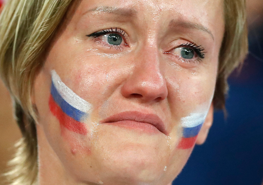 . A Russia\'s fan cries after Russia\'s loss in the quarterfinal match between Russia and Croatia at the 2018 soccer World Cup in the Fisht Stadium, in Sochi, Russia, Saturday, July 7, 2018. (AP Photo/Darko Bandic)