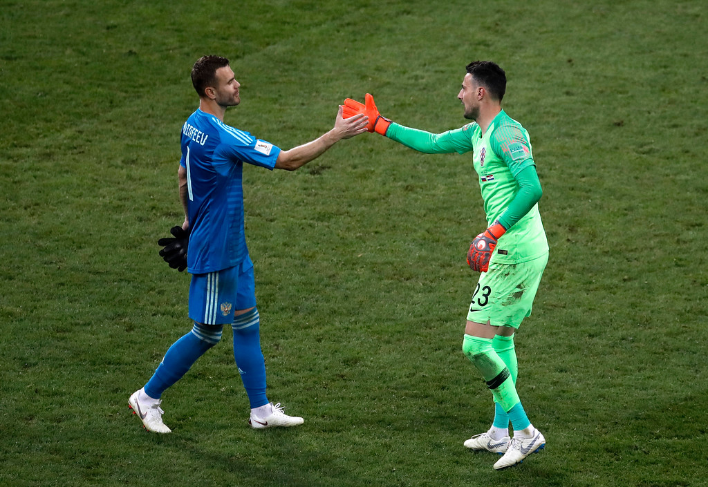 . Russia goalkeeper Igor Akinfeev, left, and Croatia goalkeeper Danijel Subasic shake hands after Croatia defeated Russia in a penalty shootout at the end of the quarterfinal match between Russia and Croatia at the 2018 soccer World Cup at the Fisht Stadium in Sochi, Russia, Saturday, July 7, 2018. (AP Photo/Alexander Zemlianichenko)