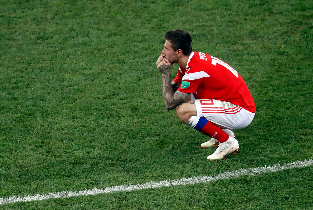. Russia\'s Fyodor Smolov reacts after Croatia defeated Russia in a penalty shootout at the end of the quarterfinal match between Russia and Croatia at the 2018 soccer World Cup at the Fisht Stadium in Sochi, Russia, Saturday, July 7, 2018. (AP Photo/Alexander Zemlianichenko)