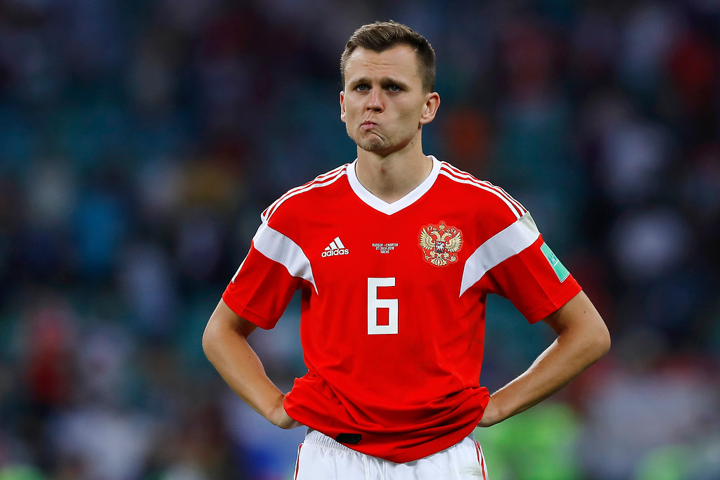. Russia\'s Denis Cheryshev stands at the end of the quarterfinal match between Russia and Croatia at the 2018 soccer World Cup in the Fisht Stadium, in Sochi, Russia, Saturday, July 7, 2018. (AP Photo/Manu Fernandez)