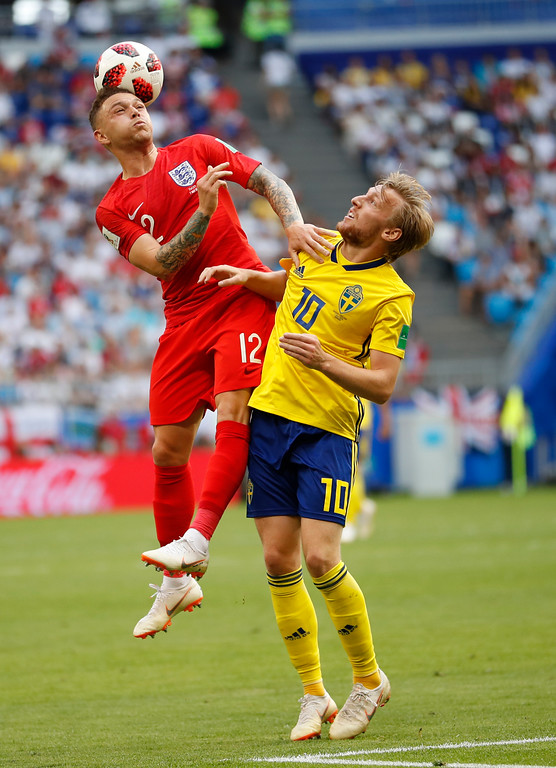. England\'s Kieran Trippier, left, and Sweden\'s Emil Forsberg battle the ball during the quarterfinal match between Sweden and England at the 2018 soccer World Cup in the Samara Arena, in Samara, Russia, Saturday, July 7, 2018. (AP Photo/Francisco Seco)
