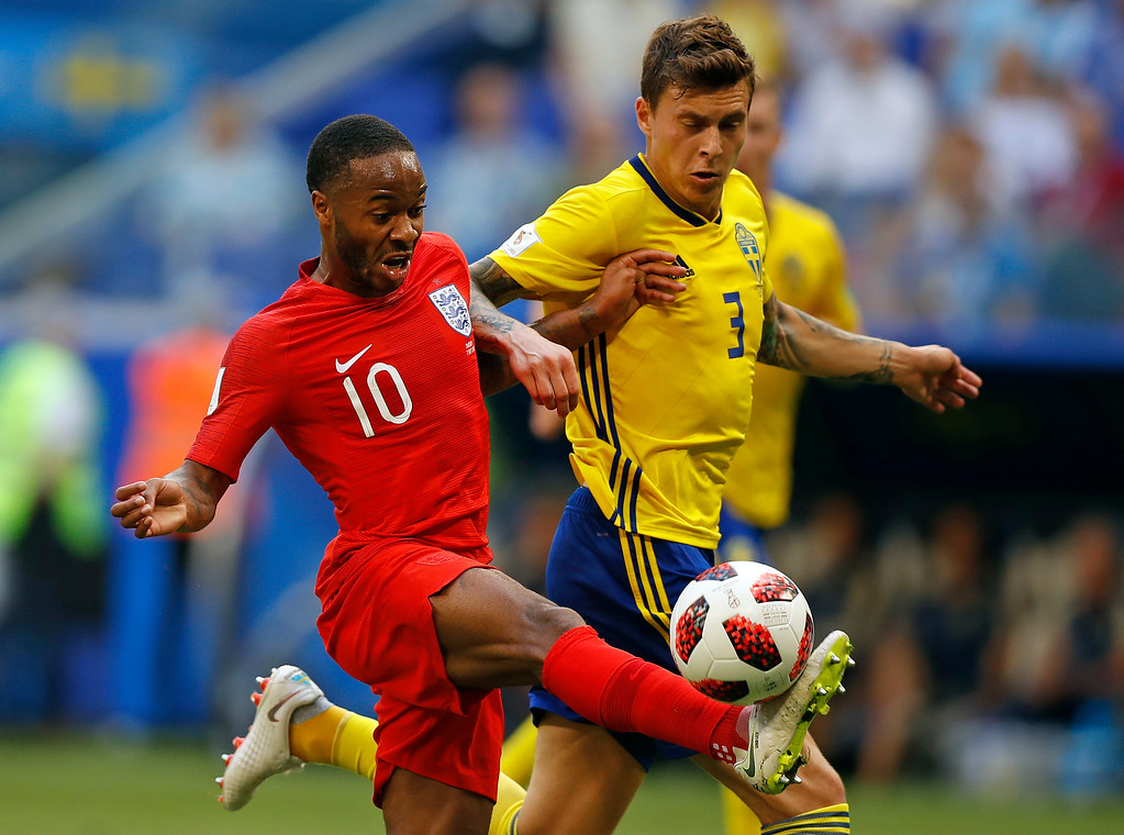 . England\'s Raheem Sterling, left, and Sweden\'s Victor Lindelof battle for the ball during the quarterfinal match between Sweden and England at the 2018 soccer World Cup in the Samara Arena, in Samara, Russia, Saturday, July 7, 2018. (AP Photo/Francisco Seco)