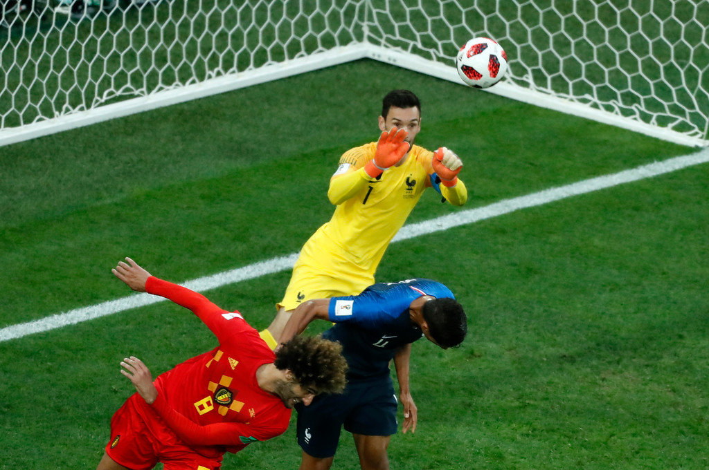 . France goalkeeper Hugo Lloris makes a save in front of Belgium\'s Marouane Fellaini, left, during the semifinal match between France and Belgium at the 2018 soccer World Cup in the St. Petersburg Stadium in St. Petersburg, Russia, Tuesday, July 10, 2018. (AP Photo/Pavel Golovkin)