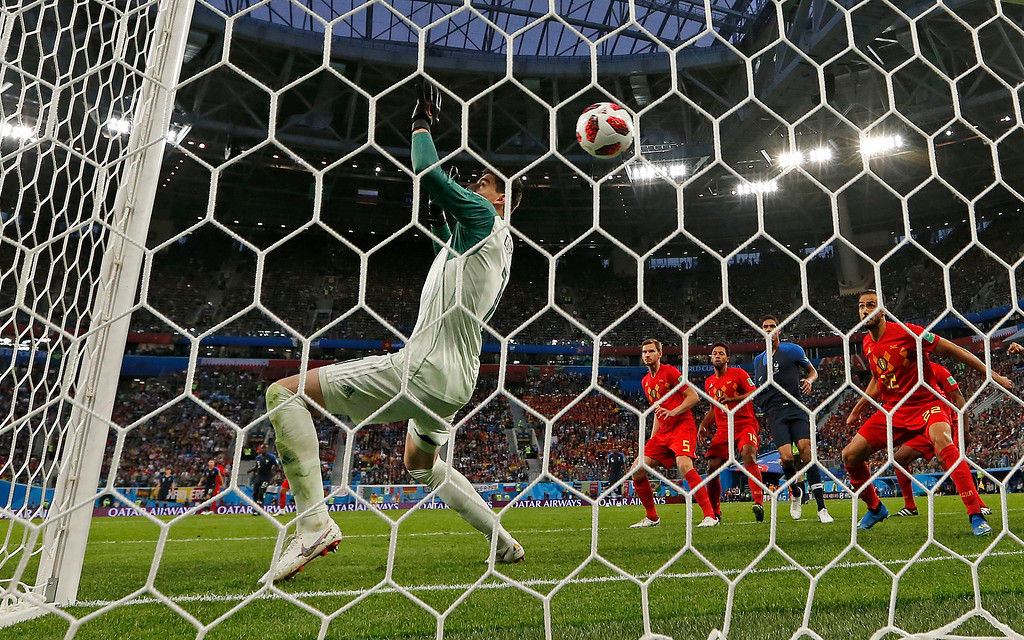 . Belgium goalkeeper Thibaut Courtois is beaten by a header from France\'s Samuel Umtiti for the opening goal during the semifinal match between France and Belgium at the 2018 soccer World Cup in the St. Petersburg Stadium, in St. Petersburg, Russia, Tuesday, July 10, 2018. (AP Photo/Natacha Pisarenko)