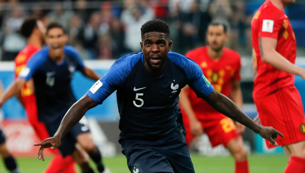 . France\'s Samuel Umtiti celebrates after scoring his sides 1st goal of the game during the semifinal match between France and Belgium at the 2018 soccer World Cup in the St. Petersburg Stadium in, St. Petersburg, Russia, Tuesday, July 10, 2018. (AP Photo/Natacha Pisarenko)