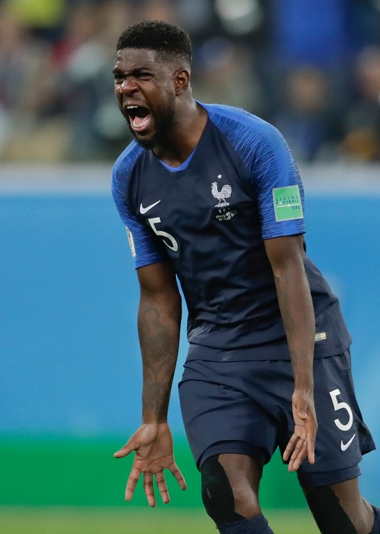 . France\'s Samuel Umtiti celebrates at the end of the semifinal match between France and Belgium at the 2018 soccer World Cup in the St. Petersburg Stadium, in St. Petersburg, Russia, Tuesday, July 10, 2018. France won 1-0. (AP Photo/Petr David Josek)