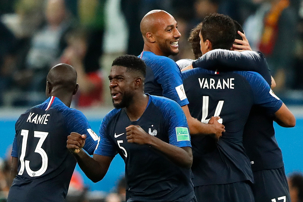 . France\'s Samuel Umtiti, foreground center, celebrates with team mates after the semifinal match between France and Belgium at the 2018 soccer World Cup in the St. Petersburg Stadium in, St. Petersburg, Russia, Tuesday, July 10, 2018. (AP Photo/Frank Augstein)