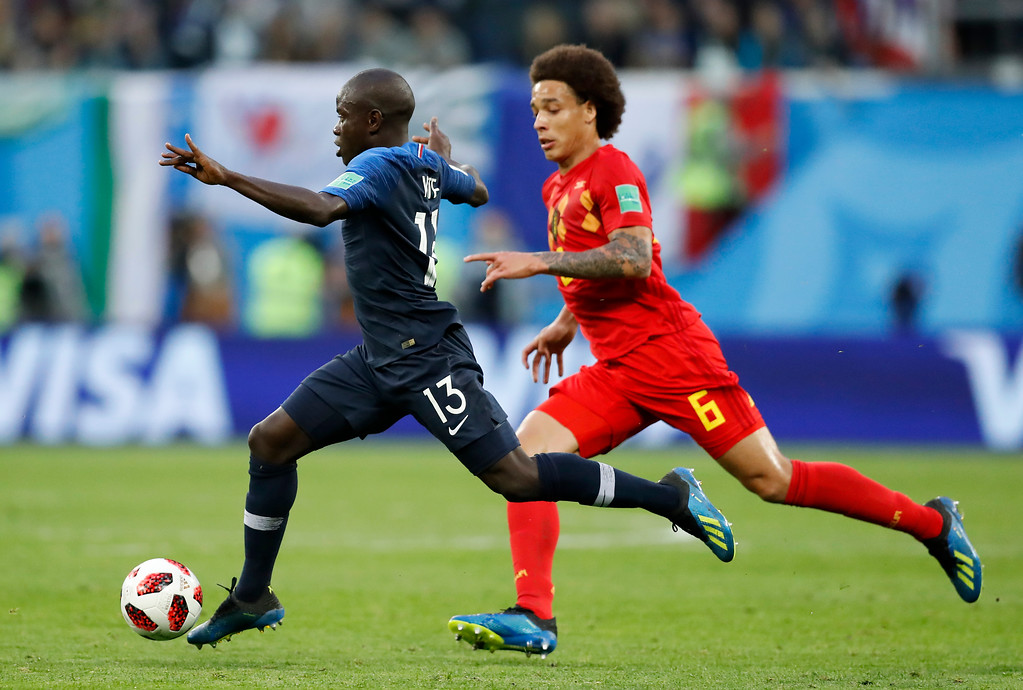. France\'s Ngolo Kante, left, challenges for the ball with Belgium\'s Axel Witsel during the semifinal match between France and Belgium at the 2018 soccer World Cup in the St. Petersburg Stadium, in St. Petersburg, Russia, Tuesday, July 10, 2018. (AP Photo/David Vincent)