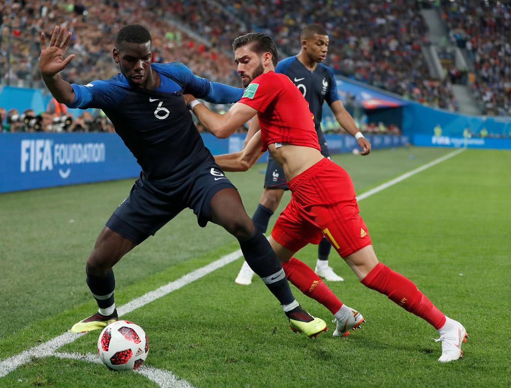 . France\'s Paul Pogba, left defends the ball from Belgium\'s Yannick Carrasco during the semifinal match between France and Belgium at the 2018 soccer World Cup in the St. Petersburg Stadium in, St. Petersburg, Russia, Tuesday, July 10, 2018. (AP Photo/Natacha Pisarenko)