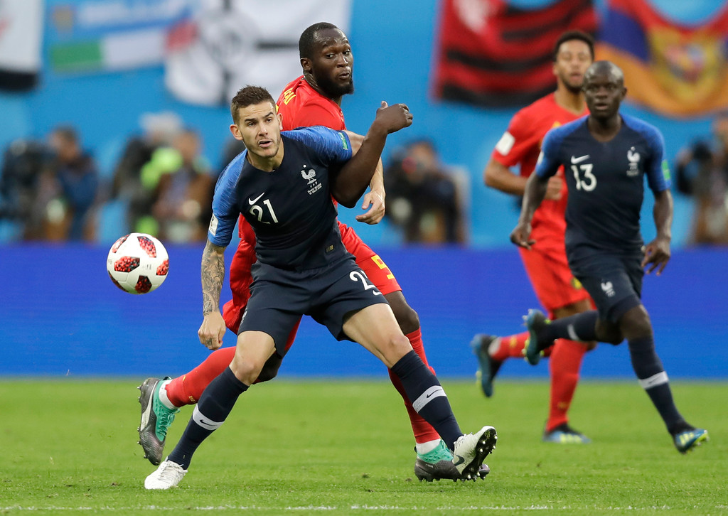 . France\'s Lucas Hernandez, left vies for the ball with Belgium\'s Romelu Lukaku during the semifinal match between France and Belgium at the 2018 soccer World Cup in the St. Petersburg Stadium in, St. Petersburg, Russia, Tuesday, July 10, 2018. (AP Photo/Natacha Pisarenko)